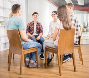 group therapy with 5 students and a therapist