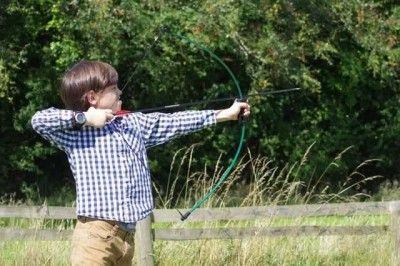 boy shooting an arrow