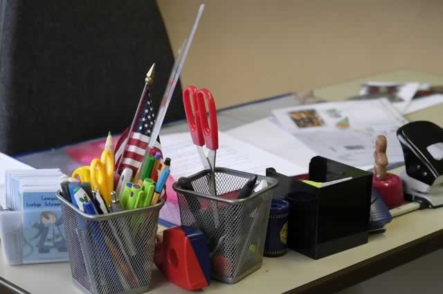 teachers desk with supplies